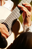 The guitar man. Hands of a guitarist at a concert Stock Photography