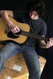 Guitar man. College-age man playing folk guitar Stock Photo