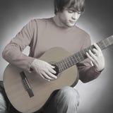 Guitar man Stock Images