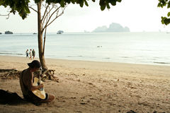 Guitar man krabi beach thailand Royalty Free Stock Images