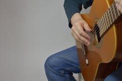 The composer composes a melody or a song on the gu Stock Photos