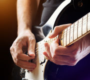Man playing guitar on a stage Royalty Free Stock Images