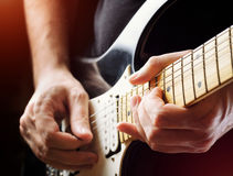 Man playing guitar on a stage. Musical concert Stock Photo