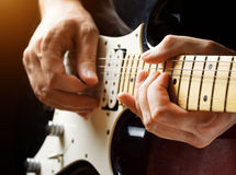 Man playing guitar on a stage stock photography