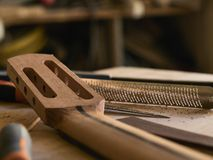The guitar master makes guitar neck. The guitar master makes a guitar neck royalty free stock photo
