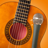 Guitar and a microphone Royalty Free Stock Image