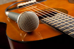 Guitar and a microphone Royalty Free Stock Photography