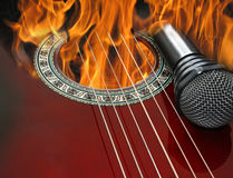 Guitar and microphone burning in the fire Royalty Free Stock Photography