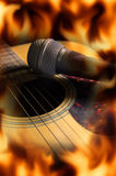 Guitar with microphone,fire flame screen. Stock Photography