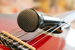 Guitar and microphone Stock Photography
