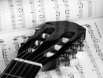Guitar and music in black and white. Reflection of notes on guitar neck Royalty Free Stock Photos