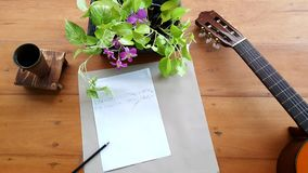 Guitar Music notes on table. Stock Image