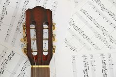 Guitar with music score background Royalty Free Stock Photography