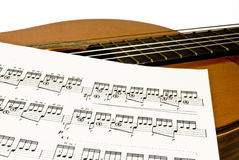 Guitar and music sheet Royalty Free Stock Image