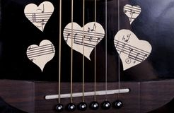 Guitar and musical heart Royalty Free Stock Images