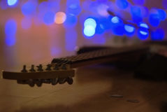 Guitar. Musical instrument guitar on the flor with light behind Stock Photo