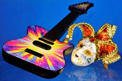 Guitar musical instrument, mask cheerful carnival performance. The mask is a symbol of theatrical transformation, change and. Mystery, real to desired. Guitar stock photos