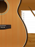 Guitar. And musical paper notes on table Royalty Free Stock Photography