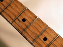 Guitar neck. Old and used maple fingerboard guitar neck Stock Image