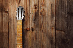 Guitar Neck. On the old wooden wall royalty free stock images