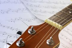 Guitar neck on the background of sheets with notes stock images