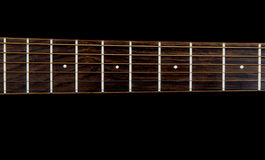 Guitar neck on a Black Background Stock Photos