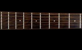 Guitar neck on a Black Background Stock Photos