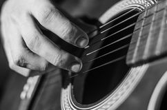 Guitar. Neck close-up on a concert of rock music in the hands of a musician Stock Photography
