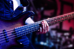 Guitar. Neck close-up on a concert of rock music in the hands of a musician Royalty Free Stock Photo