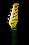 Guitar neck in the dark. Guitar neck on black background Royalty Free Stock Photo