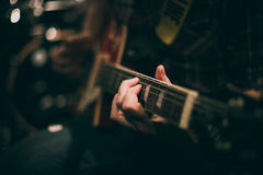 Guitar neck and hand chord. Selective focus Royalty Free Stock Image