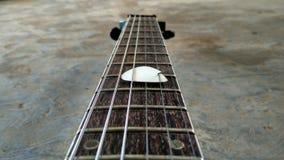 Guitar. Neck guitar with pick broken Royalty Free Stock Image