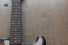 Guitar neck and plectrum. Royalty Free Stock Images