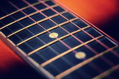 Guitar neck and strings. Close up royalty free stock images