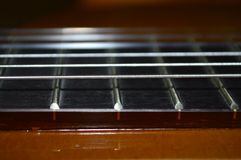 Guitar neck and strings. Close up royalty free stock photos
