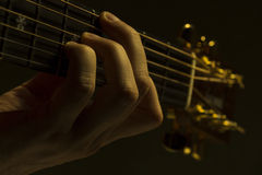 Guitar neck under dramatic light Stock Photography