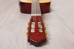 Guitar neck on a wooden background Royalty Free Stock Image