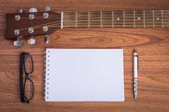 Guitar notebook, pencil and eyeglasses royalty free stock photos
