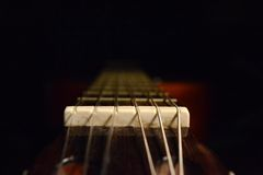 Guitar nut and strings Stock Photo
