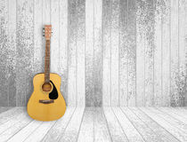 Guitar in old room background. Guitar in old empty wood room background Royalty Free Stock Image