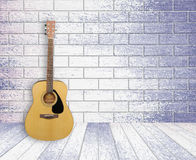 Guitar in old room background. Guitar in old empty wood room background Royalty Free Stock Photography