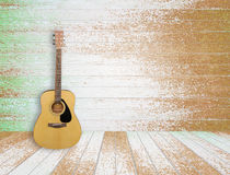 Guitar in old room background. Guitar in old empty wood room background Royalty Free Stock Photos