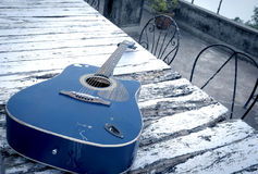 Guitar on the Old Table Stock Photography