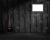 Guitar and old wooden frame Royalty Free Stock Photo