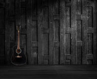 Guitar on old wooden wall. Royalty Free Stock Photography