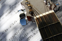 Guitar over song book. My guitar layed down over a great song book of mine Stock Photo