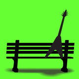 Guitar on a park bench Stock Photos