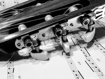 Guitar parts and music sheets. Guitar parts black and white close up picture Stock Images