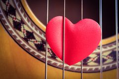 Guitar Passion. An acoustic guitar with a red love heart Stock Images