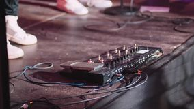 Guitar pedal and guitarist foot playing at a concert. stock footage